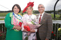 Press Eye - Belfast - Northern Ireland - 11th August 2019 - Downpatrick Racecourse Style Sunday race meeting. . Race 6:  4.30. HannonTravel.com Ladies Upstyle Hair Competition Win A Trip To Costa Blanca Handicap Hurdle of 10,000.00 2m. 5f. 165yds. (L-R) Eimer Hannon of Hannon Travel, Grainne Carr, winners of the Hanon Travel Ladies Upstyle Hair Competition and Mukesh Sharma of Hannon Travel.