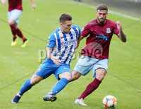 Press Eye - Belfast - Northern Ireland - 27th July 2020 - . Ballymena United FC v Coleraine FC Sadler\'s Peaky Blinder Irish Cup Semi Final at the National Football Stadium at Windsor Park.. Ballymenas Steven McCullough with Coleraines Joshua Carson. Photo by Jonathan Porter Press Eye.