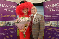 Press Eye - Belfast - Northern Ireland - 11th August 2019 - Downpatrick Racecourse Style Sunday race meeting. . (L-R) Carol Rooney, winner of the Hannon Travel Most Stylish Hat & Accessories Competition and Mukesh Sharma of Hannon Travel.