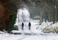 Press Eye - Belfast - Northern Ireland - 4th March 2018. As the snow in Northern Ireland begins to clear dog walkers is pictured in the Fourwinds area of south Belfast. . Picture by Jonathan Porter/PressEye