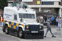 Press Eye - Belfast - Northern Ireland - 8th August 2019. Police pull out of the Newlodge area of north Belfast where a republican bonfire is due to be lit tonight.  Police had a presence in the area from this morning with some periods of trouble. . Picture by Jonathan Porter/PressEye
