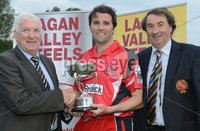 Mandatory Credit: Rowland White/Presseye. Cricket: Lagan Valley Steels Twenty20 Cup Final. Teams: Instonians 9blue) v Waringstown (red). Venue: Belmont. Date: 6th July 2012. Caption: Tommy Anderson, MD of Lagan Valley Steels, Sponsor of the Twenty20 competition, with Kyle McCallan, Waringstown Captain and Chris Harte, President of the Northern Cricket Union.