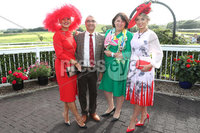 Press Eye - Belfast - Northern Ireland - 11th August 2019 - Downpatrick Racecourse Style Sunday race meeting. . (L-R) Carol Rooney, winner of the Hannon Travel  Most Stylish Hat & Accessories Competition, Mukesh Sharma of Hannon Travel, Eimer Hannon of Hannon Travel,. and Grainne Carr winner of the HannonTravel.com Ladies Upstyle Hair Competition. .
