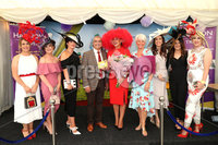 Press Eye - Belfast - Northern Ireland - 11th August 2019 - Downpatrick Racecourse Style Sunday race meeting. . (L-R) Carol Rooney, (Red Dress & Red Hat) winner of the Hannon Travel Most Stylish Hat & Accessories Competition with Mukesh Sharma of Hannon Travel, Pamela Balantine and the other finalists in the competition.
