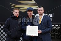 Press Eye - Belfast - Northern Ireland - 1st November 2019 - . Down Royal Racecourse - November Festival Day 1 - Friday . Race 2 - 1:10 LOUGH CONSTRUCTION LTD. IRISH EBF MARES NOVICE HURDLE . Thomas Tumelty makes a presentation to owners of Daylight Katie, David Dunsdon and Brian Cassidy after the 2nd race at Down Royal.. Photo by Kelvin Boyes / Press Eye.. .