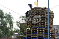 Presseye.com. 8th August 2019. General views of the Newlodge bonfire  in Belfast where police have moved in ahead of contractors which have been tasked to remove everything from the site.. Two youths pictured at the top of the pallets preventing police from moving in.. Mandatory Credit : Stephen Hamilton/Presseye