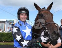 Press Eye - Belfast - Northern Ireland - 13th July 2017 . Downpatrick racecourse family fun race day.. TULLYRAINE VETERINARY CLINIC MARES MAIDEN HURDLE . Race winner Blixt with jockey Paddy Mullins on board. Picture by Matt Mackey / presseye.com.