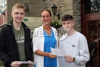 Mandatory Credit - Picture by Freddie Parkinson/Press Eye . Thursday 15 August 2019. Ballyclare High School. A Level Results on the increase once again in Ballyclare High School.. Dr Michelle Rainey Principal (Centre) with Jack Bartley 2A* and A and Luke Nugent 2A* and A