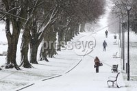 ©Lorcan Doherty February 12th 2018. Mid Term Break Snow Fall. Workers make there way through Brooke Park, Derry.