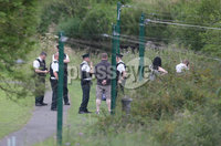Press Eye - Belfast - Northern Ireland - 14th July 2017 . The scene where police are investigating the discovery of a man\'s body in the Shaws Bridge area of South Belfast on Friday afternoon. Picture by Matt Mackey / presseye.com.