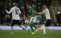 PressEye-Northern Ireland- 9th September  2019-Picture by Brian Little/PressEye. Northern Ireland Stuart Dallas challenged by  Germany Julian Brandt and Marco Reus  during Monday\'s  European Championship Qualifying Group C match  at the National  Football Stadium at Windsor Park,Belfast.. Picture by Brian Little/PressEye .