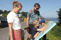 Press Eye - Helens Bay - Weather Pictures - 25th August 2019. Photograph by Declan Roughan. (L-R) Mary, James and son Rory Strong from Holywood spending the day at the beach