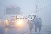 Press Eye - Belfast - Northern Ireland - 10th January 2018. School children make their way home along the Springfield Road as heavy fog covers Belfast. . Picture by Jonathan Porter/PressEye