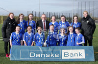 Press Eye - Belfast - Northern Ireland - 8th February 2018. IFA school girls football competition at Allen Park in Antrim.  . St Genevieve\'s, Belfast Vs Holy Cross, Strabane.. Holy Cross win and Danske Bank Antrim Branch manager Richard Laplsey presents them with the trophy. . Picture by Jonathan Porter/PressEye