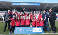 Press Eye Belfast - Northern Ireland 14th March 2019. Danske Bank Ulster Schools Girls X7s Senior Cup Final. Enniskillen Royal Grammar School(in red) vs Loreto Secondary School Letterkenny.. Enniskillen lift the cup after winning the final and are pictured with Ulster Rugby President Stephen Elliott(left) and Danske Bank Bloomfield Bangor Branch manager Nick Craig. . . Picture by Jonathan Porter/PressEye.com