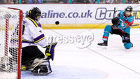 Press Eye - Belfast -  Northern Ireland - 11th February 2018 - Photo by William Cherry/Presseye. Manchester Storm netminder keeps his eye on the puck after Belfast Giants Steve Saviano has a shot during Sunday afternoons Elite Ice Hockey League game at the SSE Arena, Belfast.