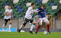 Press Eye - Belfast -  Northern Ireland - 10th July 2019 - Photo by William Cherry/Presseye/Inpho. Linfield\'s Shayne Lavery with Rosenborg\'s Mike Jensen during Wednesday nights Champions League, Qualifying First Round, 1st Leg game at the National Stadium at Windsor Park, Belfast.