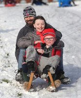©Lorcan Doherty February 12th 2018. . John Neils with his children Con (6) and Isabel (10), from Creggan, enjoying the Mid Term Break snow fall in Brooke Park, Derry