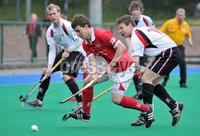 Mandatory Credit: Rowland White/Presseye. Hockey: Super 9\'s Finals. Teams: Dale Dragons (white) v Cookstown Maverics (red). Venue: Banbridge. Date: 25th April 2012. Caption: Timmy Smyth, Maverics and Peter Purcell, Dragons