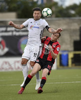 11th July 2019. Europa league First round qualifying match between Crusaders and B36 Torshavn at Seaview Belfast.. Crusaders Rory Hale  in action with Torshavns Lukasz Cieslewicz. Mandatory Credit / Stephen Hamilton/Inpho