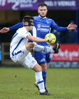 Danske Bank Premiership, Stangmore Park, Dungannon, Co. Tyrone 13/1/2018. Dungannon Swifts vs Coleraine. Dungannon\'s Ryan Harpur with Bradley Lyons of Coleraine. Mandatory Credit ©INPHO/Matt Mackey