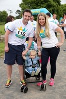 Press Eye - Belfast - Northern Ireland - 5th June 2016 - . Patricia, Chrissy and Adam McIlroy take part in the first ever Centra 5k pairs run for Action Cancer at Ormeau Park.. Over 100 families, friends and colleagues paired up today (Sunday 5th June) for the inaugural Centra Run Together event at Ormeau Park, raising vital funds for local charity Action Cancer. . Run Together is a set of four 5k races taking place across Belfast, Mid Ulster and Derry between June and October which encourage you to run with your partner, son, daughter, friend or neighbour. . Picture by Kelvin Boyes / Press Eye . .