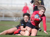 Press Eye Belfast - Northern Ireland 14th March 2019. Danske Bank Ulster Schools Girls X7s Senior Cup Final. Enniskillen Royal Grammar School(in red) vs Loreto Secondary School Letterkenny.. Enniskillen\'s India Daley pushes forward against Loreto\'s KEELEY LAFFERTY. . Picture by Jonathan Porter/PressEye.com