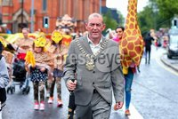 Picture -  Kevin Scott / Presseye. Belfast - Northern Ireland - Sunday 2nd August 2015 - Feile 2015 - Parade - (No Repro Fee). Lord Mayor Arder Carson . Pictured is hundreds of adults and children dressed in costume for the annual Feile parade on the Falls road in Belfast, despite the rain crowds lined the route to cheer on the performers. . Picture - Kevin Scott / Presseye