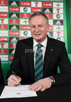 Press Eye - Belfast -  Northern Ireland - 09th February 2018 - Photo by William Cherry/Presseye. Michael O'Neill signs the four-year contract extension which will see him continue as Northern Ireland senior men's international manager until 2024..