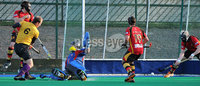 Mandatory Credit: Rowland White/Presseye. Men\'s Hockey: Irish Hockey League. Teams: Banbridge (red) v Instonians (yellow). Venue: Banbridge. Date: 14th April 2012. Caption: Panic in the Banbridge goal