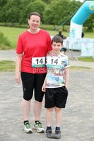 Press Eye - Belfast - Northern Ireland - 5th June 2016 - . Pauline and Ben Hamilton from Saintfield take part in the first ever Centra 5k pairs run for Action Cancer at Ormeau Park.. Over 100 families, friends and colleagues paired up today (Sunday 5th June) for the inaugural Centra Run Together event at Ormeau Park, raising vital funds for local charity Action Cancer. . Run Together is a set of four 5k races taking place across Belfast, Mid Ulster and Derry between June and October which encourage you to run with your partner, son, daughter, friend or neighbour. . Picture by Kelvin Boyes / Press Eye . .
