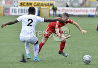 Press Eye - Belfast - Northern Ireland -15th July. Photo by Stephen Hamilton  / Press Eye.. Pre season friendly match between Cliftonville and Swansea u23 at Solitude in Belfast.. Cliftonvilles Daniel Hughes in action with Swansea\'s Tyler Reid