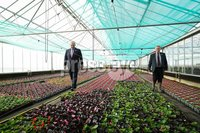Press Eye - Belfast - Northern Ireland -  4th May 2021 . Secretary of State for Northern Ireland Brandon Lewis today visited NI Centenary rose breeder Dickson Roses in Newtownards. Guided by rose breeder Colin Dickson, who wore a new Centenary rose pin, he enjoyed a tour of the gardens and viewed the Centenary rose which will be available to purchase from November 2021.. Photo by Kelvin Boyes / Press Eye.