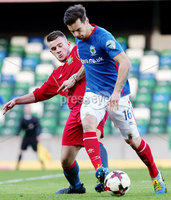 Irish Cup Fifth Round, Windsor Park, Belfast 6/1/2018. Linfield vs Glebe Rangers. Linfield\'s Matthew Clarke with Glebe\'s Jake Francis. Mandatory Credit ©INPHO/Jonathan Porter