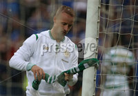 PressEye-Northern Ireland- 14th July  2017-Picture by PressEye. Celtic  Leigh Griffiths  ties a Celtic scarf to the Windsor Park goal post after the final whistle during  Friday\'s UEFA Champions League Qualifier Round 2 (First Leg) match against Linfield   at Windsor Park.. Picture by PressEye
