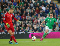 Press Eye - Belfast - Northern Ireland - 9th September 2019 . UEFA EURO Qualifier Group C at the National Stadium at Windsor Park, Belfast.  Northern Ireland Vs Germany. . Northern Ireland\'s Conor Washington with Germany\'s goalkeeper Manuel Neuer. Photo by Jonathan Porter / Press Eye.