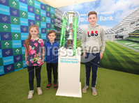 Press Eye - Belfast - Northern Ireland - 16th May 2018. First day of the 2018 Balmoral Show, in partnership with Ulster Bank, at Balmoral Park.  Ulster Bank has the NatWest Six Nations trophy at its stand over the four days of this year's Balmoral Show. Visitors to the show today had the chance to have their photo taken with the trophy which Ireland claimed this year as part of their Grand Slam success. Pictured with the trophy are Lucy McKibbin(11) from Kilkeel with her brothers Josh(8) and Jack(13). . Picture by Jonathan Porter/PressEye