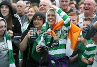Press Eye - Belfast - Northern Ireland - 14th July 2017 . Celtic fans celebrate as Celtic score. . Fans pictured at The Devenish fanzone in West Belfast as they watch Linfield v Celtic at Windsor Park, Belfast in their first Champions League game.. Picture by Matt Mackey / presseye.com.