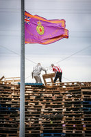 Press Eye - Belfast - Northern Ireland - 11th July 2019 - Picture Matt Mackey / Press Eye.. Bonfire builders at the Avoneil bonfire in East Belfast.. It is understood the council were not able to secure a willing contractor to remove the materials.