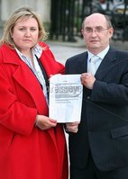 Presseye.com 30th January 2008. Picture by Jonathan Porter.  SDLP MLA Thomas Burns today apologised in court after being sued by Eastwood Ltd over allegations about an asbestos plant planning application.  John Eastwood and his wife Suzanne pictured outside the High Court in Belfast with their apology from Thomas Burns.