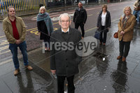 Press Eye - Belfast - Northern Ireland - 20th November  2020. Alan Black the sole survivor of the Kingsmill massacre is taking legal action at the High Court to have two IRA men suspected of involvement in the murders publicly named. . Pictured are (L-R) Alan Black and solicitor Kevin Winters. Centre is Alan Black with (L-R) Alan Black Junior, Karen Armstrong, Robert Smith, Mandy McMahon and Tania Smith.. Picture by Declan Roughen / PressEye. .