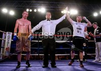 Picture -  Kevin Scott / Presseye. Belfast - Northern Ireland - Saturday 1st August 2015 - Feile Big Fight Night - (No Repro Fee) . Pictured is the fight between Paddy Gallagher (Black Shorts) vs William Warburton (Gold Shorts) at the Feile big fight night in Belfast, Northern Ireland . . Picture - Kevin Scott / Presseye