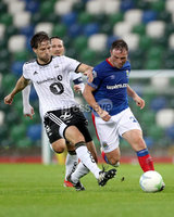 Press Eye - Belfast -  Northern Ireland - 10th July 2019 - Photo by William Cherry/Presseye/Inpho. Linfield\'s Jamie Mulgrew with Rosenborg\'s Marius Lundemo during Wednesday nights Champions League, Qualifying First Round, 1st Leg game at the National Stadium at Windsor Park, Belfast.