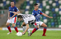 Press Eye - Belfast -  Northern Ireland - 10th July 2019 - Photo by William Cherry/Presseye/Inpho. Linfield\'s Jordan Stewart with Rosenborg\'s Marius Lundemo during Wednesday nights Champions League, Qualifying First Round, 1st Leg game at the National Stadium at Windsor Park, Belfast.
