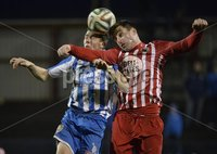 Presseye.com 20th  December  2014. Danske Bank Irish premier league match between Coleraine and Warrenpoint town at Ballycastle road Coleraiane.. Colleraines Ian Parkhill   in action with Warrenpoints John Doyle. Photograph:Stephen Hamilton
