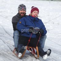 ©Lorcan Doherty February 12th 2018. . John and Nicola Nelis, from Creggan, enjoying the Mid Term Break snow fall in Brooke Park, Derry.