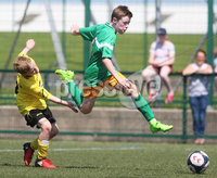 ©/Presseye.com - 9th July 2017.  Press Eye Ltd - Northern Ireland - Hughes Insurance Foyle Cup 2017- Mini Soccer U-10 - Clonmany Sdhamrocks (Donegal) V Aileach FC (Donegal). Clonmany Shamrock\'s Oisin Cooney hurdles this challenge from Aileach\'s Andrew Walker..  . Mandatory Credit Photo Lorcan Doherty / Presseye.com