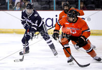 Press Eye - Belfast, Northern Ireland - 30th November 2019 - Photo by William Cherry/Presseye. Princeton Tigers\' Mike Ufberg with UNH Wildcats\' Lucas Herrmann during Saturday afternoons Friendship Four game at the SSE Arena, Belfast.      Photo by William Cherry/Presseye