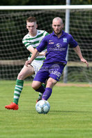 © Press Eye.com 12th August 2017. NIFL Championship 1. Lurgan Celtic v Newry City.. Celtic\'s Aaron Rodgers. and Newry\'s Stephen Hughes. during Saturday\'s match at Knockramer Park. Photo by TONY HENDRON/Presseye.com