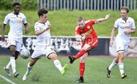 Press Eye - Belfast - Northern Ireland -15th July. Photo by Stephen Hamilton  / Press Eye.. Pre season friendly match between Cliftonville and Swansea u23 at Solitude in Belfast.. Cliftonvilles Chris Curran  in action with Swansea\'s Jack Evans
